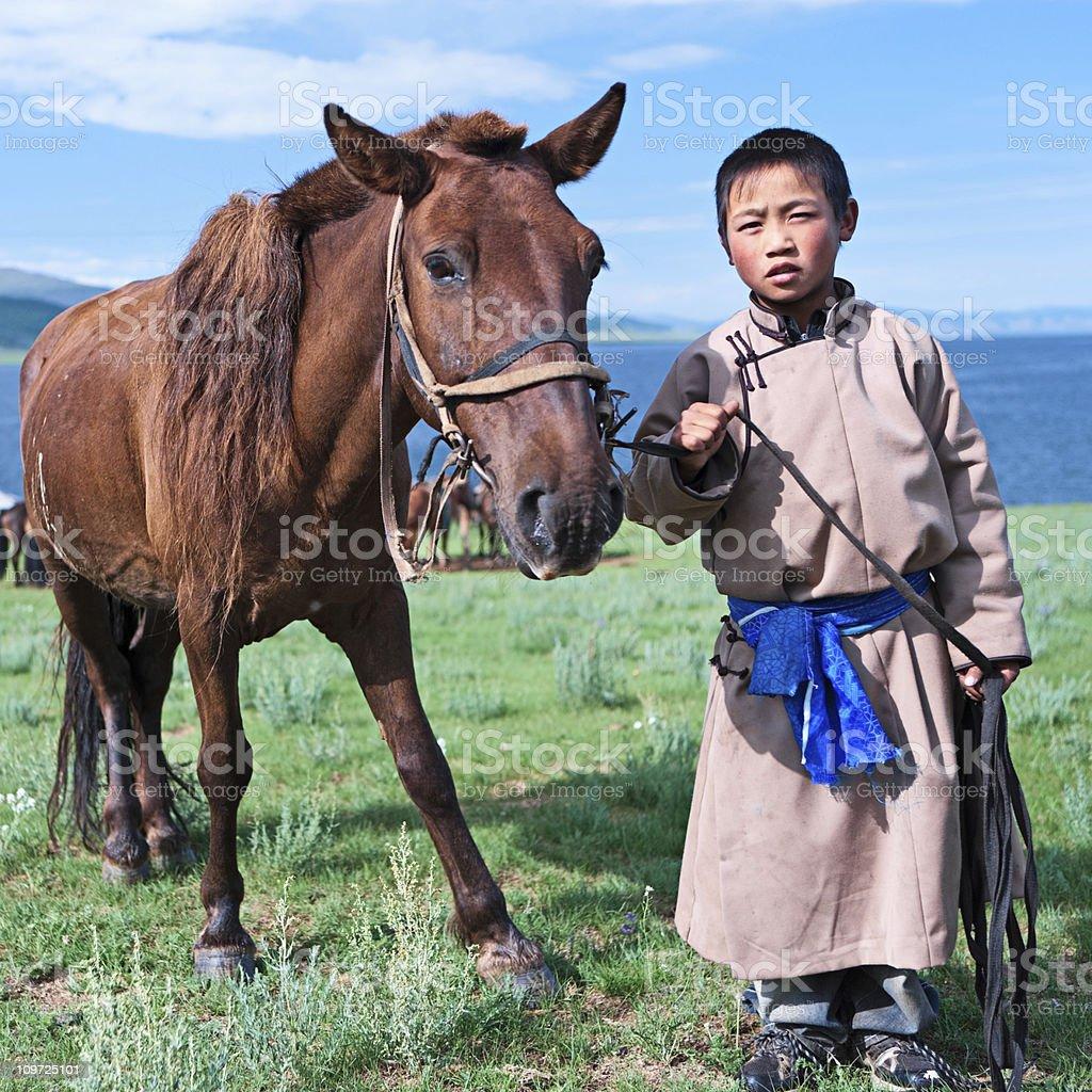 Young Mongolian horseback rider royalty-free stock photo