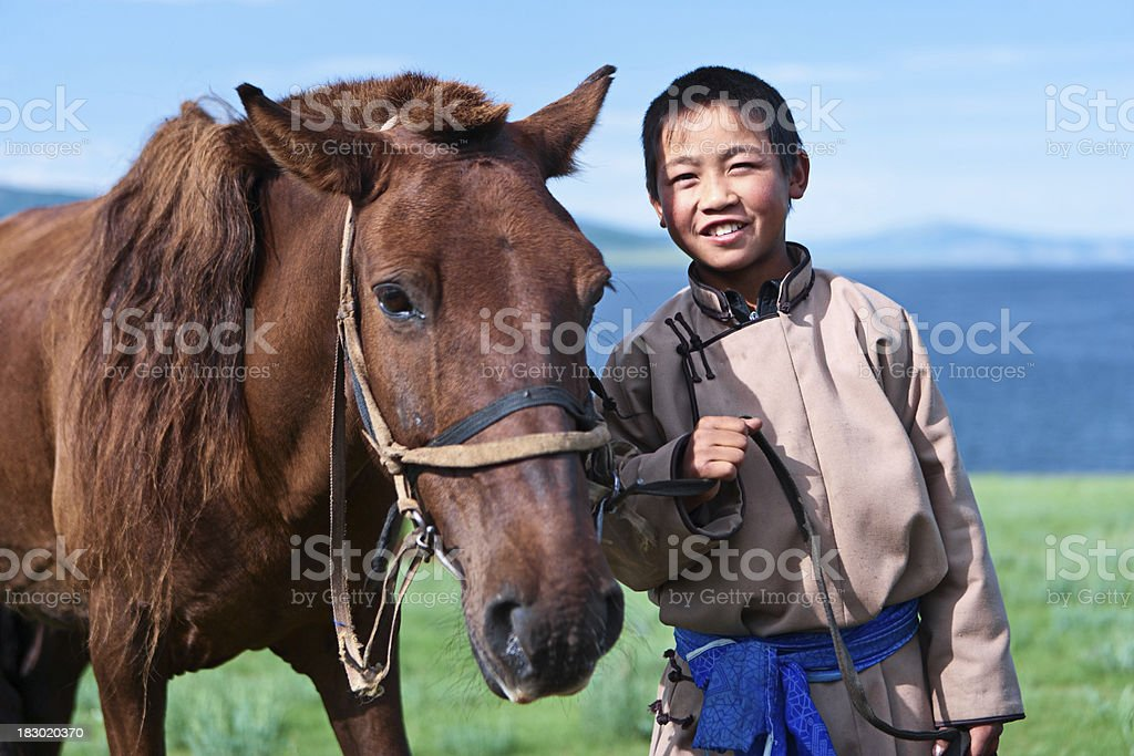 Young Mongolian horseback rider stock photo