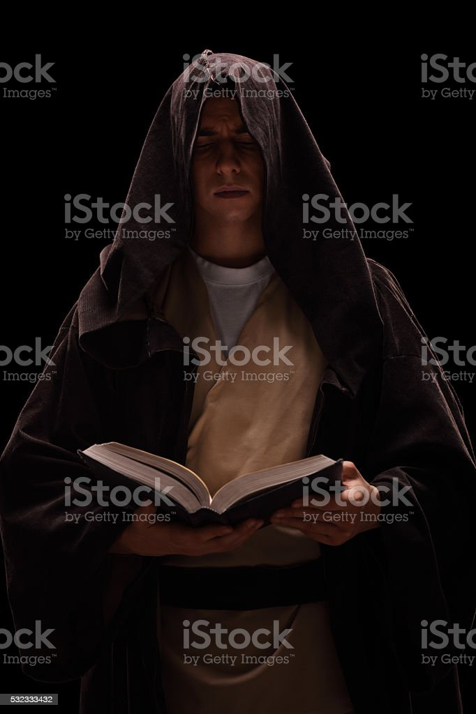 Young monk reading a book stock photo