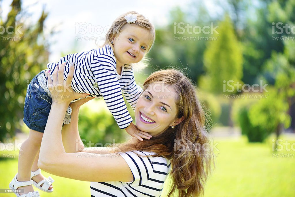 Young mother and cute daughter at park royalty-free stock photo
