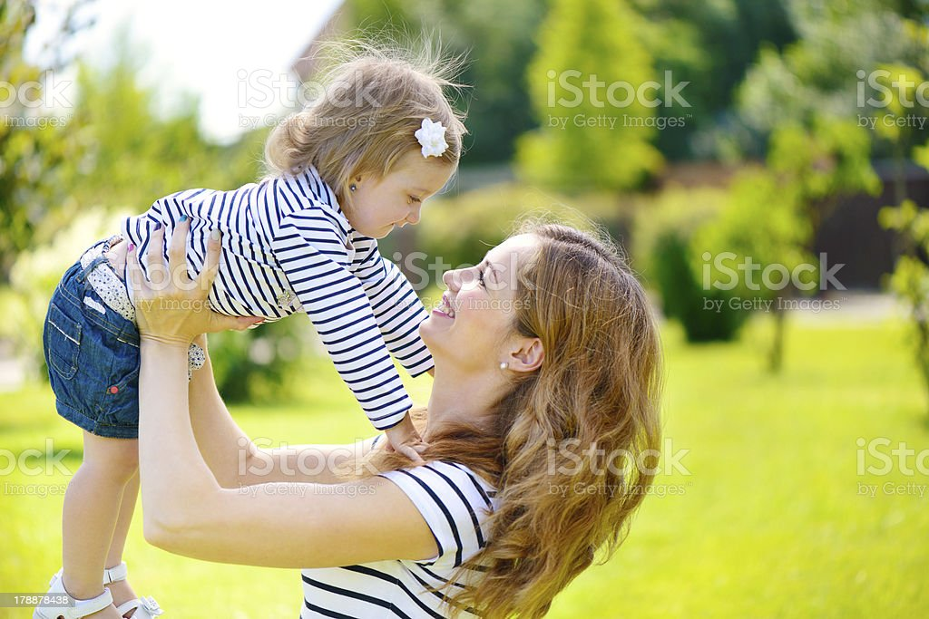 Young mother and cute daughter playing royalty-free stock photo