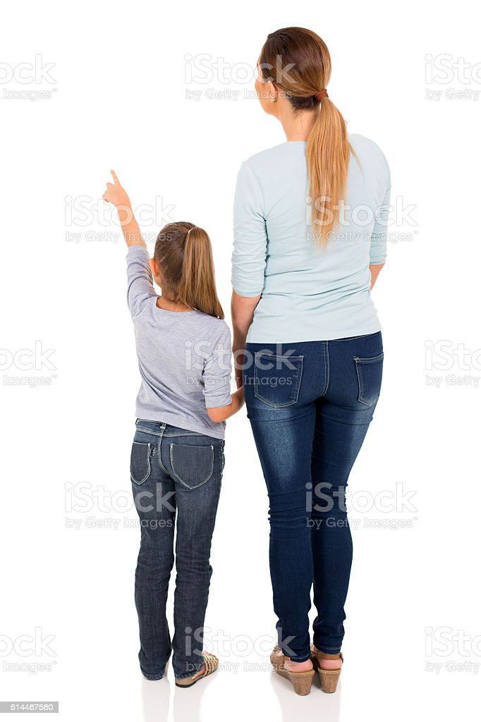 young mother and daughter pointing stock photo