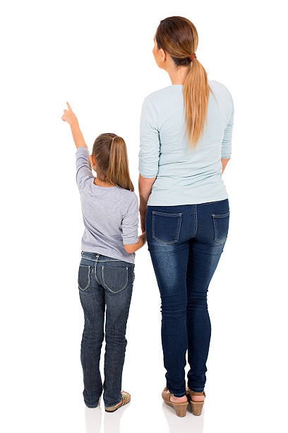 young mother and daughter pointing - rear view stock photos and pictures