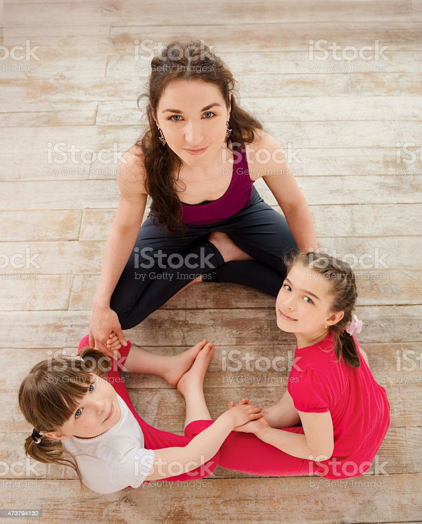 Young mother and daughter sitting on the floor stock photo