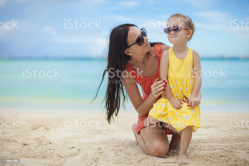 Young mother and her cute daughter have fun royalty-free stock photo