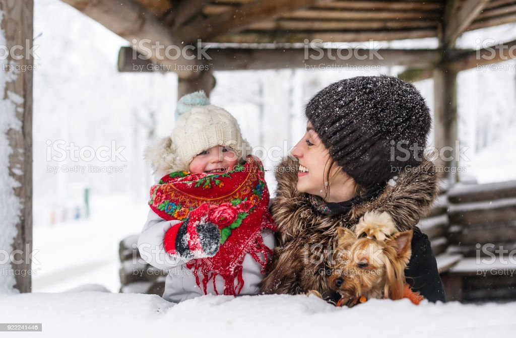 Young mother and her daughter at winter day stock photo