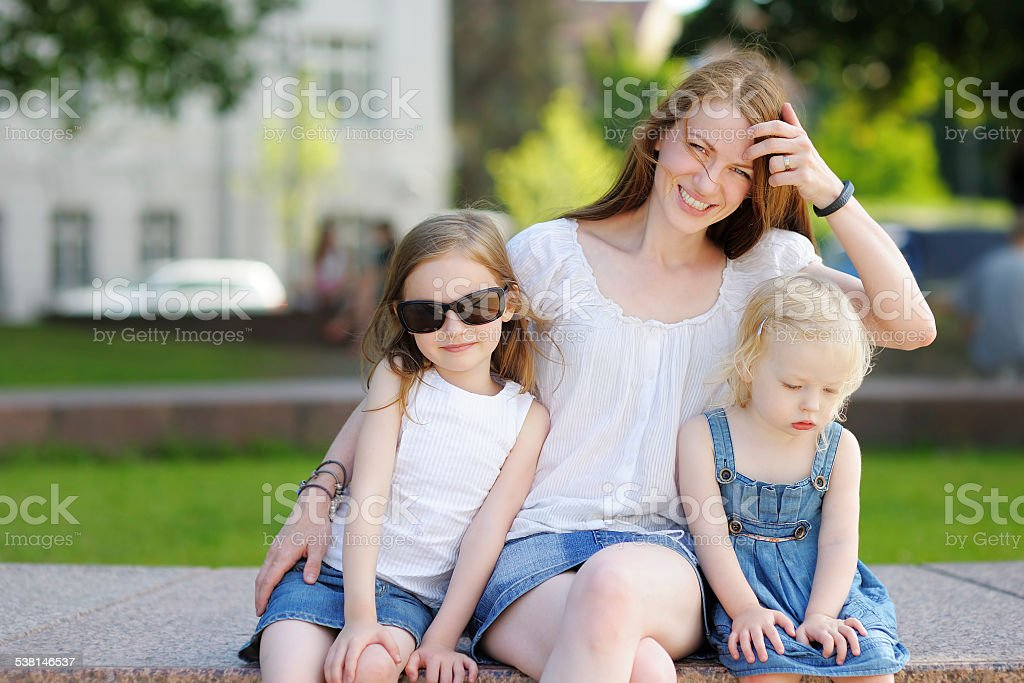 Young mother and her daughters royalty-free stock photo