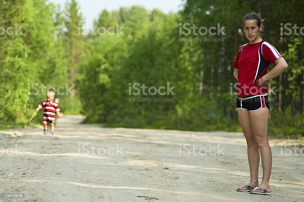 Young mother and her son are walking royalty-free stock photo