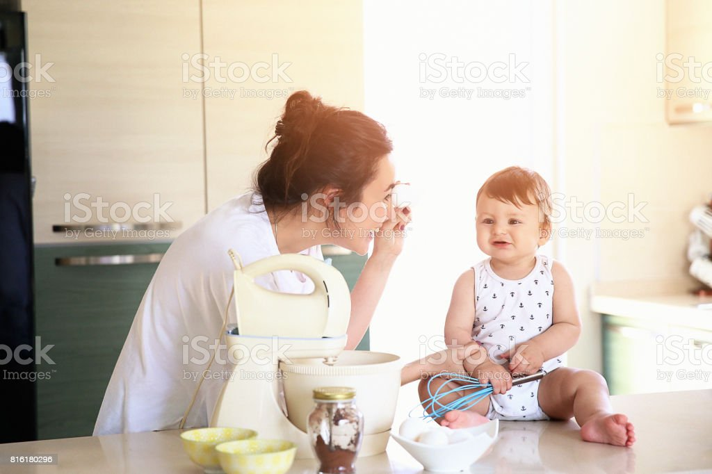 Young mother and kid baking a pie stock photo