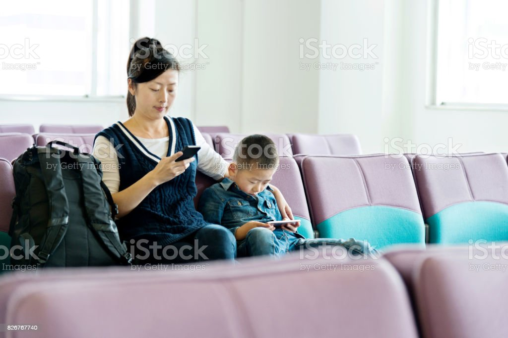 Young mother and son at airport stock photo