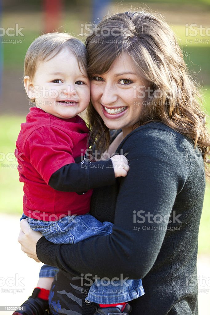 Young mother and son at the park royalty-free stock photo