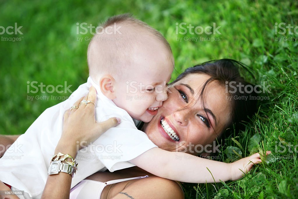 Young Mother and Son Playing in Grass royalty-free stock photo