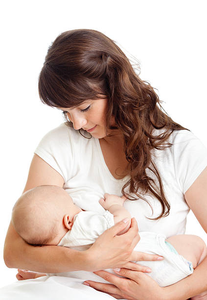 young mother breast feeding her infant stock photo