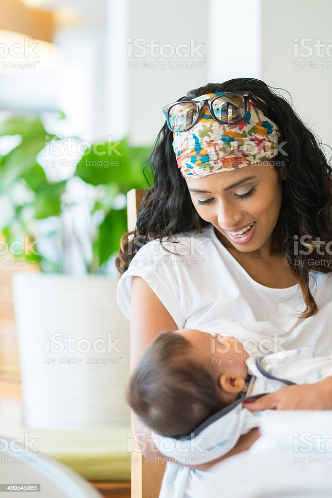 Young mother breastfeeding her baby stock photo