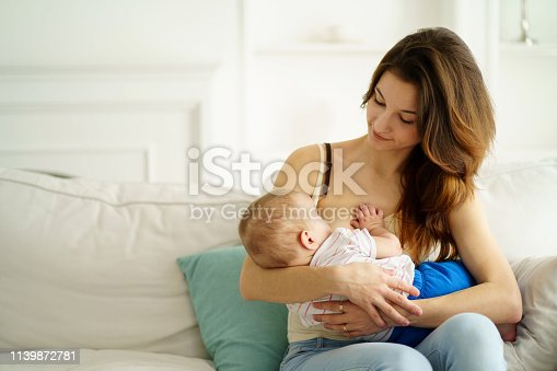breastfeed, motherhood, Mothers day, family love. mom breastfeeding her little son. breast feeding, lactation, maternity and healthy lifestyle