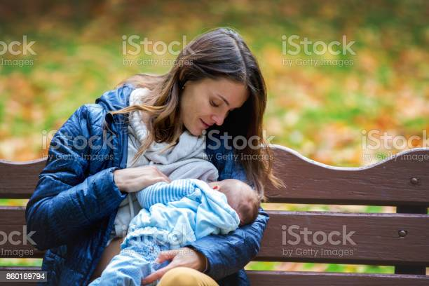 Young mother breastfeeding her newborn baby boy outdoor in the park picture id860169794?b=1&k=6&m=860169794&s=612x612&h= pknbrb87mf8pqnqbwucwg8tytbnslpvaymtuhat0bm=