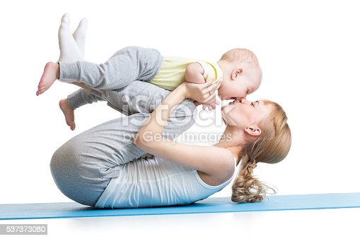 istock young mother does fitness exercises together with kid boy 537373080