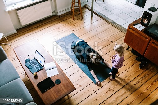 Photo series of stay-at-home mother and daughter during lockdown exercising and doing yoga together.