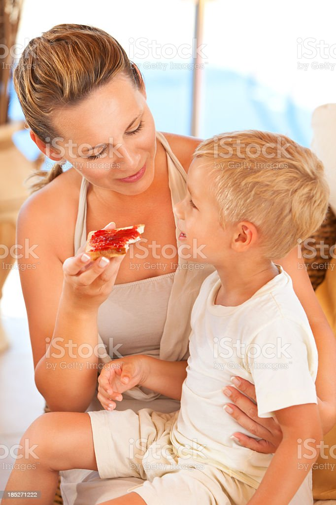 Young mother feeding her little boy royalty-free stock photo
