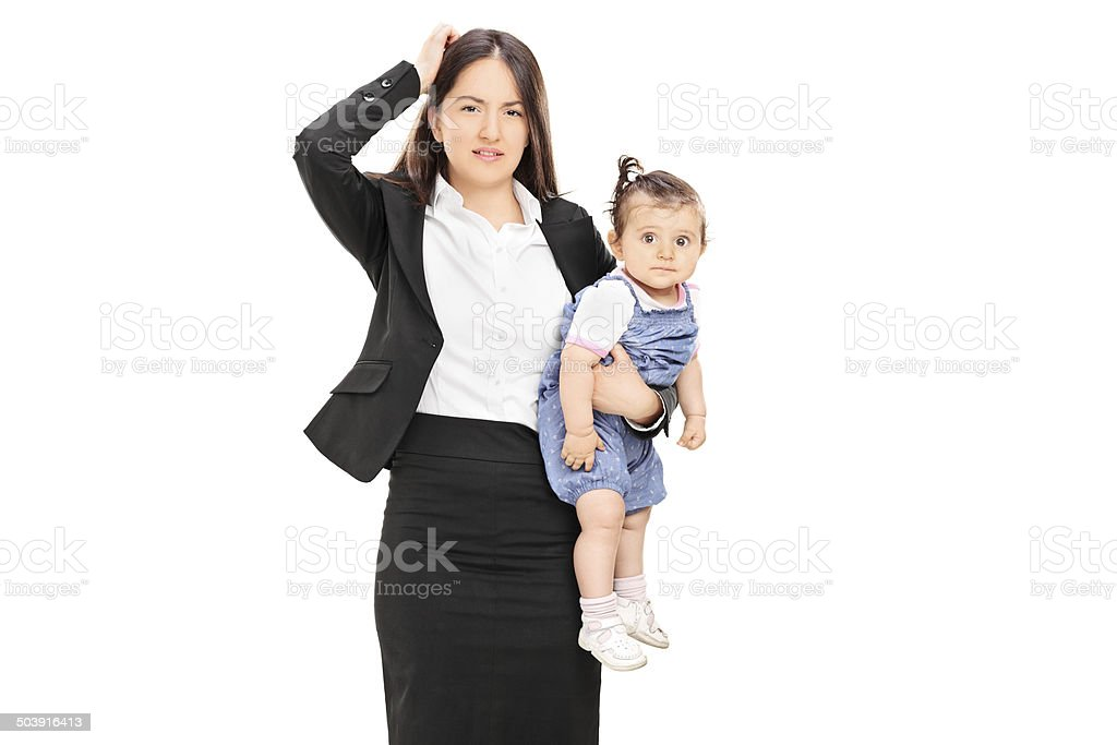 Young mother holding her baby daughter stock photo