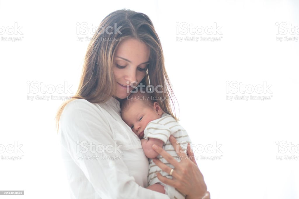 Young mother, holding her newborn baby boy stock photo