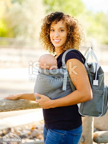 628820352 istock photo Young Mother in the Park 1039182000