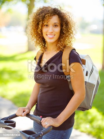 628820352 istock photo Young Mother in the Park 1039182304