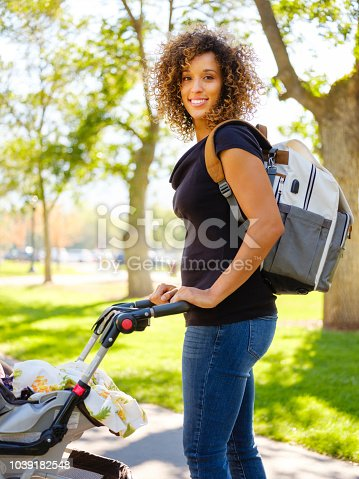 628820352 istock photo Young Mother in the Park 1039182548