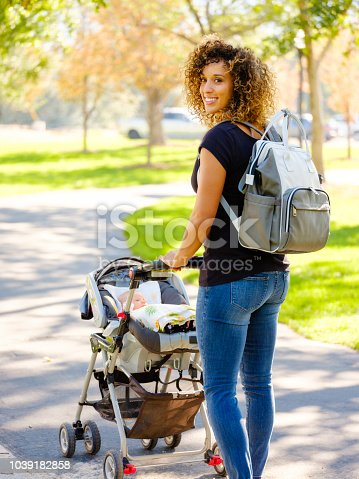 628820352 istock photo Young Mother in the Park 1039182858