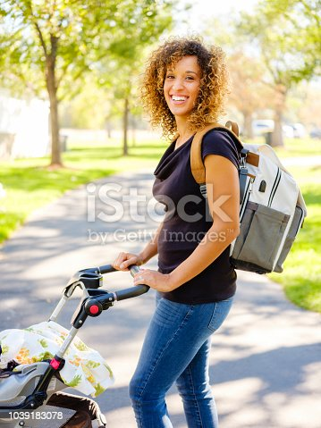 628820352 istock photo Young Mother in the Park 1039183078
