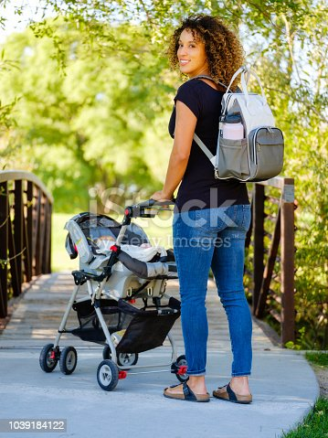 628820352 istock photo Young Mother in the Park 1039184122