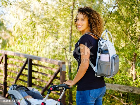 628820352 istock photo Young Mother in the Park 1039184134