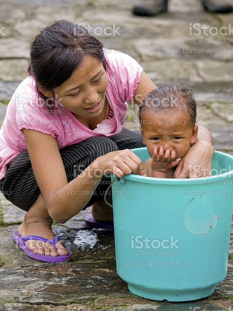 Young mother is washing her daughter royalty-free stock photo