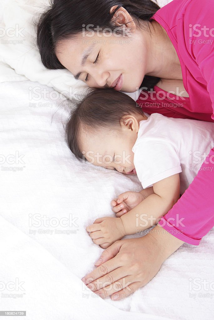 Young mother look her sleeping baby royalty-free stock photo