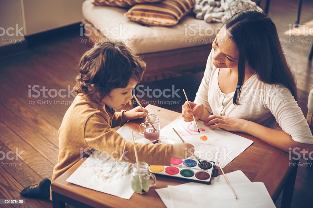 Young mother painting with son stock photo