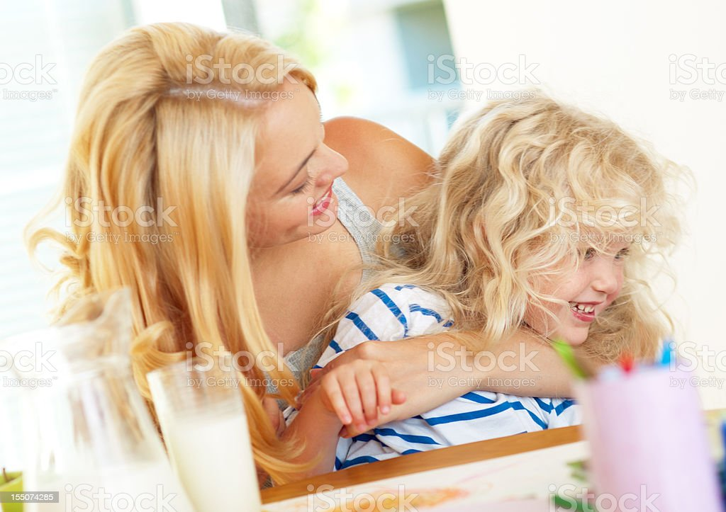 young mother paying with her daughter royalty-free stock photo