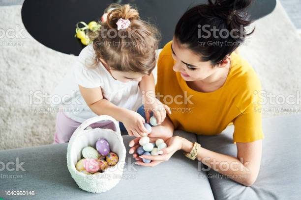 Young mother preparing easter decorations with her daughter picture id1040960146?b=1&k=6&m=1040960146&s=612x612&h=fnhd sgcnbf63lplav ezfet9nsnxkrdj7lqf7l7tvy=