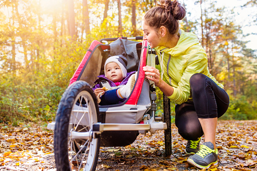 istock Young mother running 500785660