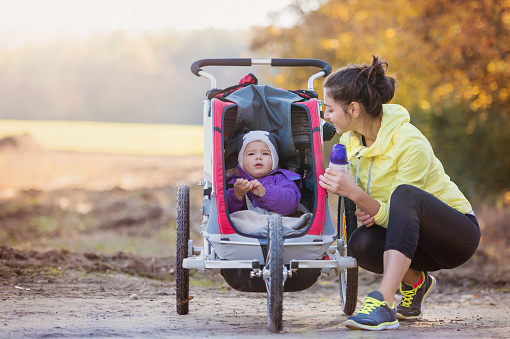 istock Young mother running 501204458