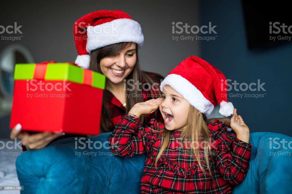 Young Mother Show Little Surprised Daughter Santas Gift At Home ...