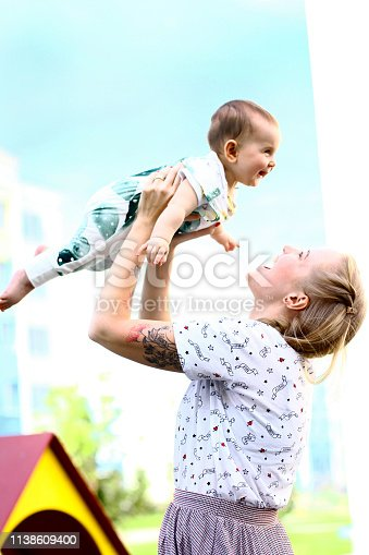 istock Young mother with a baby in her arms 1138609400