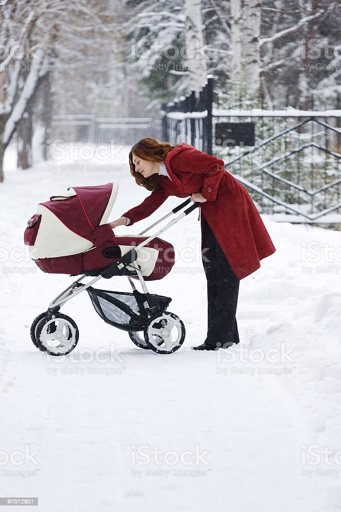 young mother with baby carriage royalty-free stock photo