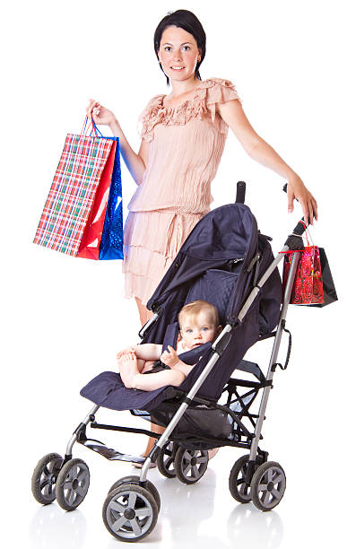 Young mother with baby in perambulator stock photo