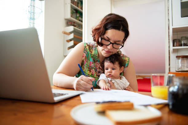 Young mother working from home stock photo