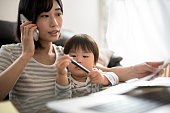 istock young mother working in house with her child 831730758