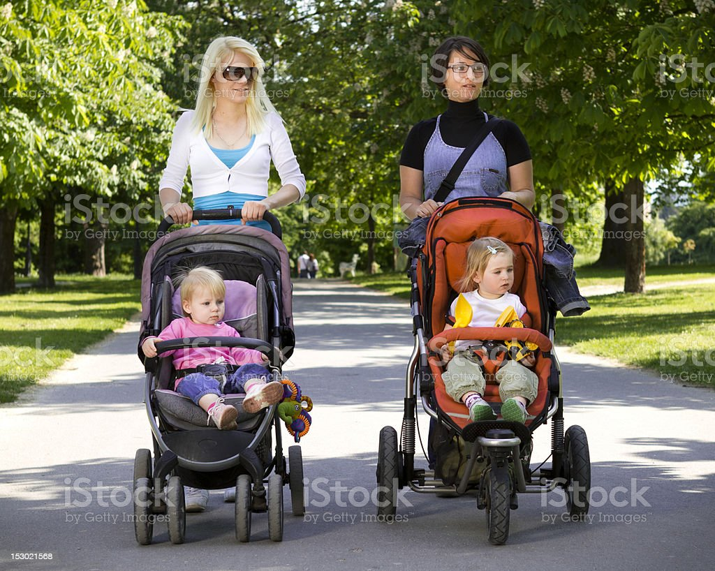 Young mothers in the park royalty-free stock photo