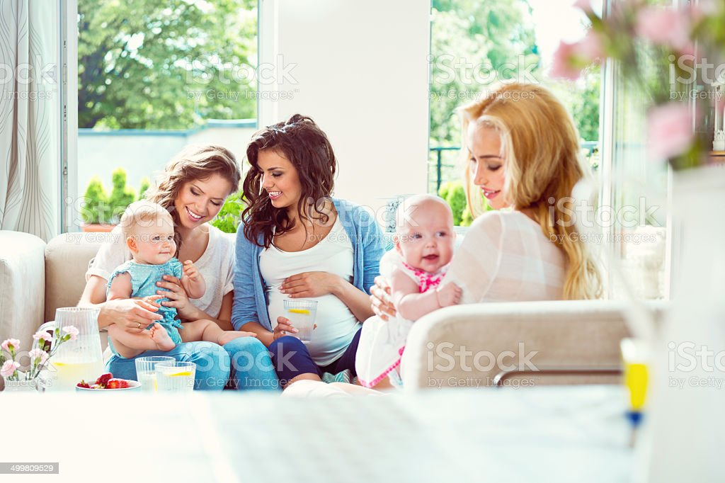 Young mothers with babies stock photo