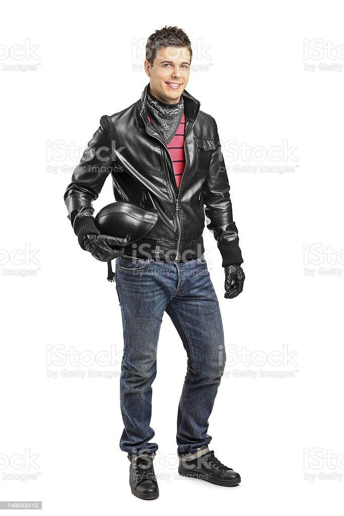 Jeune motorcycler tenant un casque - Photo