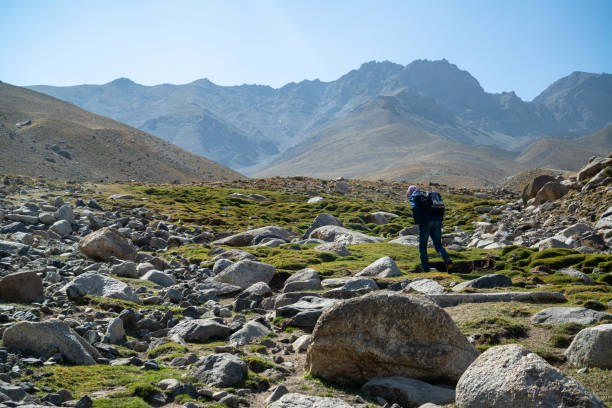 Young mountain guide in Afghanistan mountains in Wakhan Corridor stock photo