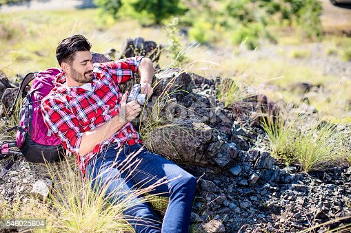 867295412 istock photo Young mountaineer resting from hiking 546025604